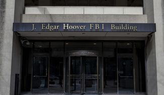 The J. Edgar Hoover FBI Building is shown on Monday, March 4, 2019, in Washington. (AP Photo/Alex Brandon) ** FILE **