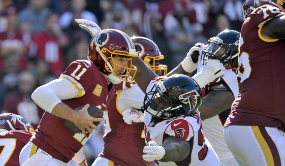 FILE - In this Nov. 4, 2018, file photo, Washington Redskins quarterback Alex Smith (11) is sacked by Atlanta Falcons defensive tackle Grady Jarrett, right, during an NFL football game in Landover, Md. The Falcons placed a franchise tag on Jarrett before the NFL deadline on Tuesday, March 5, 2019.  (AP Photo/Mark Tenally) ** FILE **