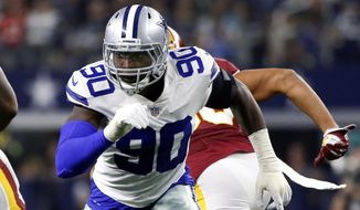 FILE - In this Nov. 22, 2018, file photo, Dallas Cowboys defensive end Demarcus Lawrence (90) rushes during the first half of an NFL football game against the Washington Redskins in Arlington, Texas. The Cowboys placed a franchise tag on Lawrence before the NFL deadline on Tuesday, March 5, 2019. (AP Photo/Ron Jenkins, File) **FILE**