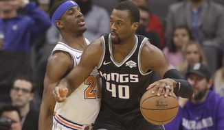Sacramento Kings forward Harrison Barnes, right, works against New York Knicks guard Damyean Dotson during the first quarter of an NBA basketball game Monday, March 4, 2019, in Sacramento, Calif. (AP Photo/Rich Pedroncelli)