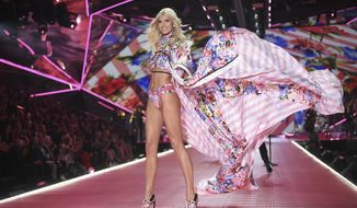 FILE- In this Nov. 8, 2018, file photo model Devon Windsor walks the runway during the 2018 Victoria's Secret Fashion Show at Pier 94 in New York. Shares in the company that owns Victoria Secret and Bath & Body Works are surging after a hedge fund began pushing for a sale or turning the latter into a separate, publicly traded company. Barington Capital Group laid out those recommendations and others in a letter Tuesday, March 5, 2019, to L Brands CEO Leslie Wexner. (Photo by Evan Agostini/Invision/AP, File)