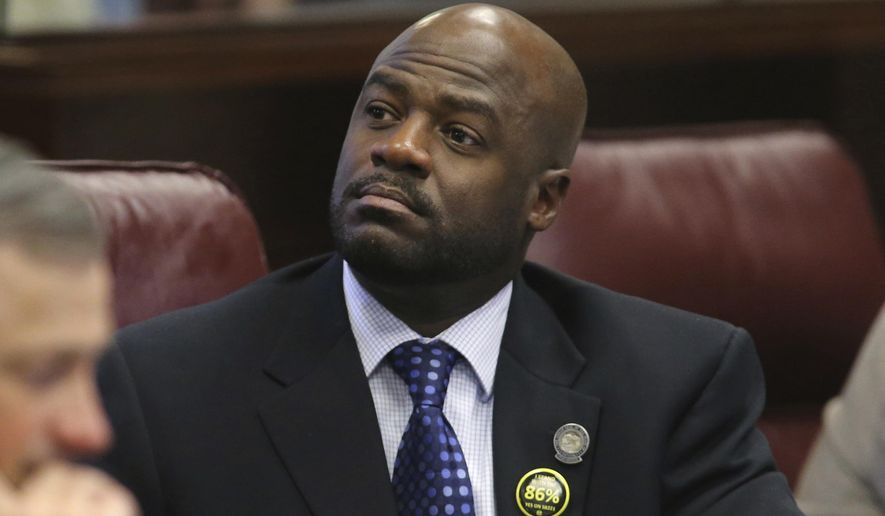 "FILE - In this May 22, 2013, file photo, Nevada Sen. Kelvin Atkinson, D-North Las Vegas, listens to debate on the Senate floor at the Legislative Building in Carson City, Nev. Nevada Gov. Steve Sisolak says Nevada Senate Majority Leader Kelvin Atkinson is resigning from the state Senate following allegations he misappropriated campaign funds for his personal use. Sisolak said in a statement Tuesday, March 5, 2019, that he's ""extremely disappointed"" in the news and said it goes ""goes against the integrity every elected officer in the state of Nevada should uphold."" (AP Photo/Cathleen Allison, File)"