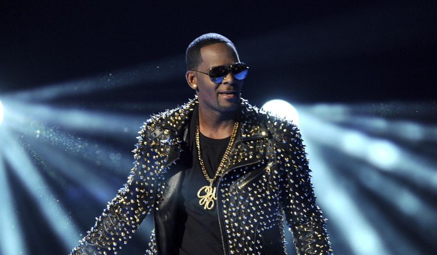 In this June 30, 2013, file photo, R. Kelly performs at the BET Awards in Los Angeles. (Photo by Frank Micelotta/Invision/AP, File)