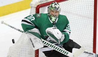 Dallas Stars goaltender Ben Bishop (30) defends the coal during the second period of an NHL hockey game against the New York Rangers in Dallas, Tuesday, March 5, 2019. (AP Photo/LM Otero) B