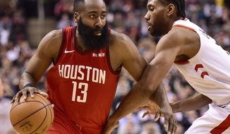 Houston Rockets guard James Harden (13) controls the ball as Toronto Raptors forward Kawhi Leonard (2) defends during the second half of an NBA basketball game Tuesday, March 5, 2019, in Toronto. (Frank Gunn/The Canadian Press via AP)