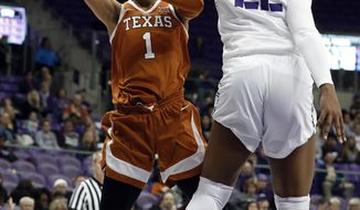 Texas guard Sug Sutton (1) has her shot blocked by TCU center Jordan Moore (22) during the first half of an NCAA college basketball game in Fort Worth, Texas, Tuesday, March 5, 2019. (AP Photo/Tony Gutierrez)