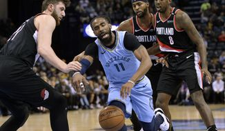Memphis Grizzlies guard Mike Conley (11) is fouled as he drives between Portland Trail Blazers center Jusuf Nurkic, from left, and forwards Maurice Harkless and Al-Farouq Aminu (8) in the first half of an NBA basketball game, Tuesday, March 5, 2019, in Memphis, Tenn. (AP Photo/Brandon Dill)