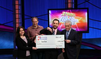 "This photo provided by Sony shows Brad Rutter, Larissa Kelly and David Madden with Alex Trebek, winners of the first-ever ""Jeopardy!"" team championship, Tuesday, March 5, 2019 in in Burbank, Calif. With $1 million at stake, a big Daily Double bet by Rutter positioned his team for a runaway victory as the quiz show's ""All-Star Games"" ended Tuesday.  Rutter and teammates Larissa Kelly and David Madden split the top prize.  (Carol Kaelson /Sony via AP)"