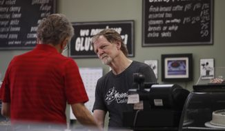 File - In this June 4, 2018, file photo, baker Jack Phillips, owner of Masterpiece Cakeshop, manages his shop in Lakewood, Colo. The state of Colorado and Phillips who refuses to make wedding cakes for gay and transgender customers on religious grounds have agreed to end their legal fight. A statement from the Colorado Attorney General's office on Tuesday, March 5, 2019, announced that the state and cakeshop owner Jack Phillips mutually agreed to end litigation in state and federal courts. (AP Photo/David Zalubowski, File)