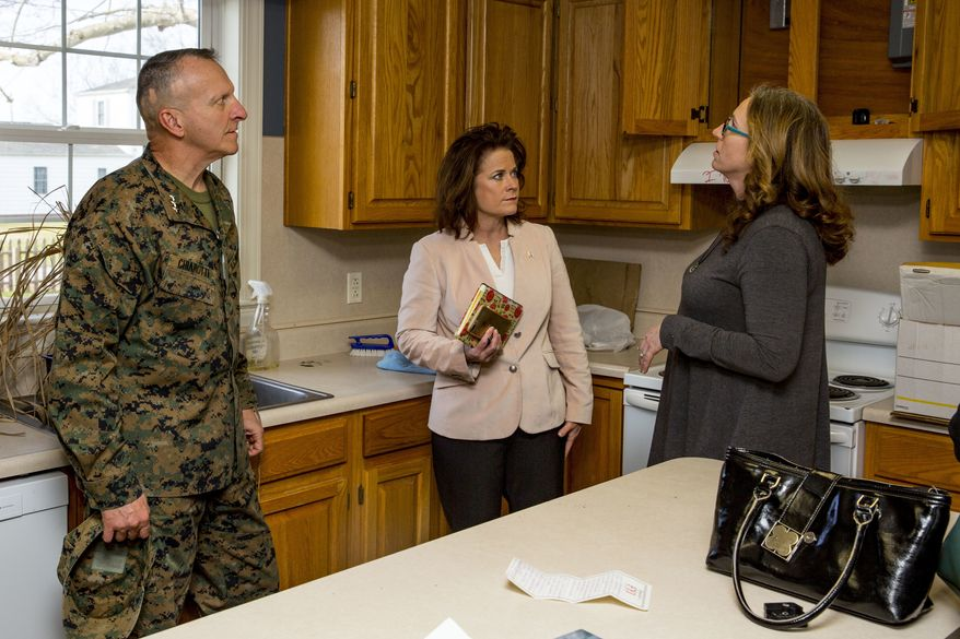 Lt. Gen. Charles G. Chiarotti, left, deputy commandant, Installations and Logistics, and the Honorable Mrs. Phyllis L. Bayer, center, assistant secretary of the Navy for energy, installations and the environment tour privatized military housing with spouses during a visit to Marine Corps Base Camp Lejeune, North Carolina, Feb. 15, 2019. Bayer visited MCB Camp Lejeune residential communities to assess on going restoration efforts on the installation. (U.S. Marine Corps photo by Lance Cpl. Isaiah Gomez)