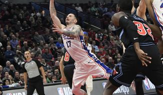 Philadelphia 76ers guard JJ Redick (17) shoots the ball against the Chicago Bulls during the first half of an NBA basketball game Wednesday, March 6, 2019, in Chicago. (AP Photo/David Banks)