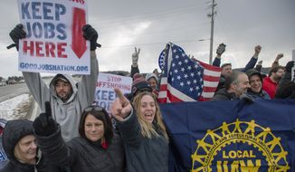 Amy Drennen, center, of Lordstown, Ohio, an employee at General Motors for 12 years, gathers with other supporters and laid off workers outside General Motors assembly plant, Wednesday, March 6, 2019, in Lordstown, Ohio. Wednesday is the last day of the plant's Chevrolet Cruze production, a move that will eliminate nearly 1,700 hourly jobs and idle the plant. (Steph Chambers/Pittsburgh Post-Gazette via AP)