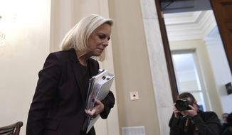 In this file photo, Kirstjen Nielsen arrives to testify on Capitol Hill in Washington, Wednesday, March 6, 2019, before the House Homeland Security Committee. (AP Photo/Susan Walsh)