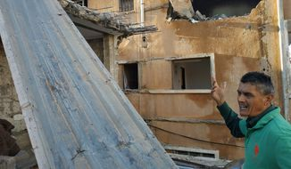 Hassan al-Mogharbi works on repairing his house on Shahat Street, in downtown Benghazi, Libya, in this Dec. 5, 2018, file photo. His house was air bombed by Haftar's forces. (Maryline Dumas/Special to the Washington Times) ** FILE **