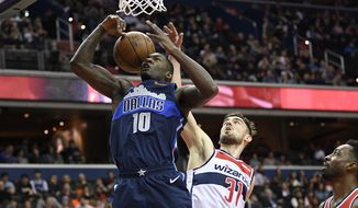 Washington Wizards guard Tomas Satoransky (31) battles for the ball against Dallas Mavericks forward Dorian Finney-Smith (10) during the first half of an NBA basketball game Wednesday, March 6, 2019, in Washington. At right is Wizards forward Jeff Green. (AP Photo/Nick Wass)
