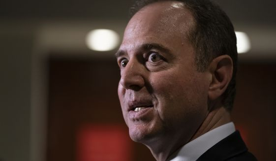 """Rep. Adam Schiff, chairman of the House Intelligence Committee, talks briefly to reporters after testimony by Michael Cohen, President Donald Trump's former lawyer, at the Capitol in Washington, Wednesday, March 6, 2019. Schiff said Cohen was """"fully cooperative"""" and """"answered every question put to him by members of both parties."""" (AP Photo/J. Scott Applewhite)"""