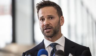 Former U.S. Rep. speaks to reporters at the Dirksen Federal Courthouse, Wednesday, March 6, 2019. Schock has agreed to repay tens of thousands of dollars in taxes and to campaign committees in exchange for prosecutors dismissing his felony corruption case.  (Ashlee Rezin/Chicago Sun-Times via AP)