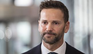 Former U.S. Rep. Aaron Schock speaks to reporters at the Dirksen Federal Courthouse, Wednesday, March 6, 2019. Schock has agreed to repay tens of thousands of dollars in taxes and to campaign committees in exchange for prosecutors dismissing his felony corruption case.  (Ashlee Rezin/Chicago Sun-Times via AP)