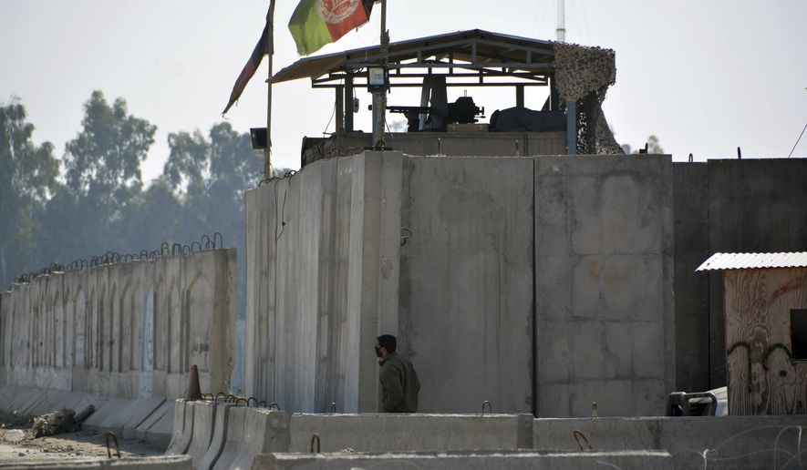 An Afghan security personnel stand guard in the checkpoint of airport after a suicide attack in Jalalabad province, east of Kabul, Afghanistan, Wednesday, March 6, 2019. Militants in Afghanistan set off a suicide blast on Wednesday morning and stormed a construction company near the airport in Jalalabad, the capital of eastern Nangarhar province, officials said.  (AP Photo/Mohammad Anwar Danishyar)