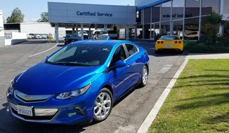 This undated photo provided by Edmunds shows a 2016 Chevrolet Volt at a Southern California Chevy dealership. In 2016, Americans leased 4.3 million new vehicles, most of which are scheduled to be turned in to dealerships this year. Those who want to lease again will find higher sticker prices, higher interest rates and, as a consequence, monthly payments that could be much higher. (Edmunds via AP)