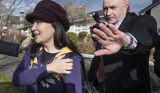 Huawei chief financial officer Meng Wanzhou, left, leaves her home to attend a court appearance in Vancouver, British Columbia, Wednesday, March 6, 2019. The executive was arrested in December at Vancouver's airport at the request of U.S. authorities and Canada announced last week it intends to proceed with the extradition case. (Darryl Dyck/The Canadian Press via AP)