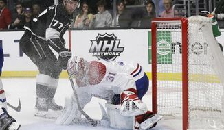 Montreal Canadiens goaltender Carey Price, right, stop a shot from Los Angeles Kings' Jeff Carter (77) during the second period of an NHL hockey game Tuesday, March 5, 2019, in Los Angeles. (AP Photo/Marcio Jose Sanchez)