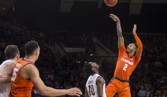 Clemson's Marcquise Reed (2) shoots over Notre Dame's T.J. Gibbs Jr. (10) during the first half of an NCAA college basketball game Wednesday, March 6, 2019, in South Bend, Ind. (AP Photo/Robert Franklin)