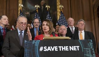 """Speaker of the House Nancy Pelosi, D-Calif., joined by Senate Minority Leader Chuck Schumer, D-N.Y., left, announces the """"Save The Internet Act,"""" congressional Democrats' plan to reinstate """"net neutrality"""" rules that President Donald Trump repealed in 2017, during an event at the Capitol in Washington, Wednesday, March 6, 2019. The bill is sponsored by Rep. Mike Doyle, D-Pa., right, with House Energy and Commerce Committee Chair Frank Pallone, D-N.J., far right. (AP Photo/J. Scott Applewhite)"""