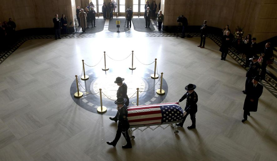 The casket of Oregon's Secretary of State Dennis Richardson is brought into the rotunda at the Oregon State Capitol in Salem, Ore., on Wednesday, March 6, 2019. (Anna Reed/Statesman-Journal via AP)