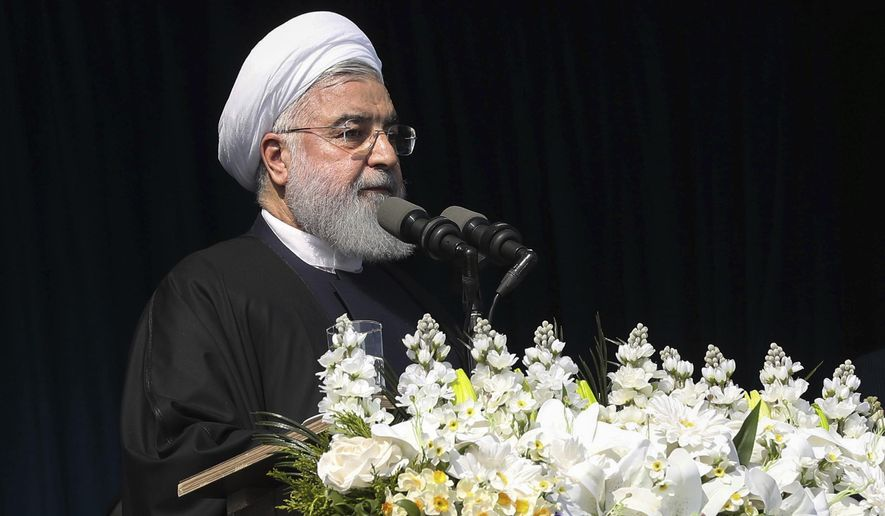 In this photo released by an official website of the office of the Iranian Presidency, Iran's President Hassan Rouhani speaks to the crowed in northern city of Lahijan, Iran, Wednesday, March 6, 2019. Rouhani says there's no chance of negotiations or compromise with the United States, because Washington allegedly is seeking to topple the government in Tehran. (Iranian Presidency Office via AP)