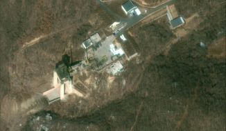 This satellite image provided by DigitalGlobe, was captured on March 2, 2019, and shows the rocket test stand at the Sohae Satellite Launch Facility in Tongchang-ri, North Korea. North Korea is restoring facilities at the long-range rocket launch, which it dismantled last year as part of disarmament steps, according to foreign experts and a South Korean lawmaker who was briefed by Seoul's spy service. The finding follows a high-stakes nuclear summit last week between North Korean leader Kim Jong Un and President Donald Trump that ended without any agreement. (DigitalGlobe, a Maxar company, via AP)