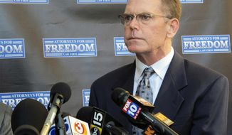 FILE - In this Feb. 2, 2018 file photo, Douglas Haig takes questions from reporters at a news conference in Chandler, Ariz. A trial date has been reset for Haig, who is facing a federal ammunition-manufacturing charge in Las Vegas in connection with the deadliest mass shooting in the nation's modern history. He has denied a charge that he illegally made armor-piercing and incendiary bullets found in a room from which the shooter staged the attack. (AP Photo/Brian Skoloff, File)