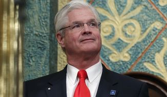"""FILE - In this Feb. 12, 2019 photo, state Senate Majority Leader Mike Shirkey, R-Clarklake, watches during the State of the State address at the state Capitol in Lansing, Mich. The top Republican lawmaker is strongly criticizing Gov. Gretchen Whitmer's proposal to raise taxes on some businesses while providing relief to retirees and low-income workers. Shirkey said Wednesday, March 6, 2019, that """"taking actions like that would be doubling down on stupid."""" The Democratic governor outlined the tax overhaul in her budget Tuesday. It's an attempt to reverse parts of a tax rewrite enacted by her Republican predecessor. (AP Photo/Al Goldis, File)"""