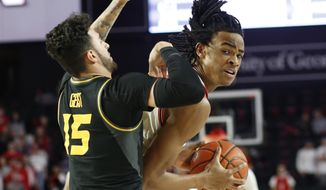 Georgia forward Nicolas Claxton (33) tries to get by Missouri guard Jordan Geist (15) during the first half of an NCAA college basketball game Wednesday, March 6, 2019, in Athens, Ga. (Joshua L. Jones/Athens Banner-Herald via AP)