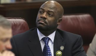 FILE - In this May 22, 2013, file photo, Nevada Sen. Kelvin Atkinson, D-North Las Vegas, listens to debate on the Senate floor at the Legislative Building in Carson City, Nev. On Wednesday, March 6, 2019, state Sen. Nicole Cannizzaro was named majority leader as Nevada Senate Democrats made new leadership postings while trying to recover from a political bombshell in which its former majority leader resigned after admitting he took campaign funds for personal use. In a sudden downfall, Atkinson on Tuesday announced his resignation on the Senate floor and said he will plead guilty when the time comes.(AP Photo/Cathleen Allison, File)