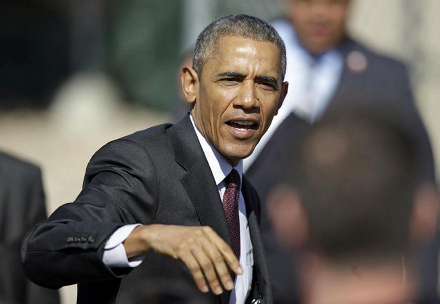 In this April 3, 2015, file photo, President Barack Obama leaves after Hill Air Force Base, Utah. (AP Photo/Rick Bowmer, File)