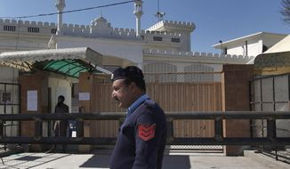 A Pakistani police officer stands guard outside a mosque belonging to a banned religious group in Islamabad, Pakistan, Wednesday, March 6, 2019. Pakistan on Wednesday continued a crackdown on seminaries, mosques and hospitals belonging to outlawed groups, saying the actions were part of the government efforts aimed at fighting terrorism, extremism and militancy. (AP Photo/Anjum Naveed)