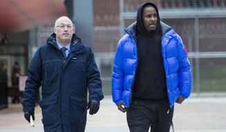 """FILE - In this Monday, Feb. 25, 2019 file photo, R. Kelly walks out of Cook County Jail with his defense attorney, Steve Greenberg, after posting $100,000 bail, in Chicago. In his first interview since being charged with sexually abusing four people, including three underage girls, R. Kelly says he """"didn't do this stuff"""" and he's """"fighting for his life. Kelly gave the interview to Gayle King of """"CBS This Morning,"""" with excerpts airing Tuesday night, March 5, 2019, and the full interview airing Wednesday and Thursday morning. (Ashlee Rezin/Chicago Sun-Times via AP, File)"""