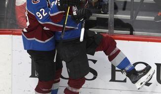 Colorado Avalanche left wing Gabriel Landeskog (92) hugs right wing Mikko Rantanen (96) after Rantanen's goal against the Detroit Red Wings during the third period of an NHL hockey game in Denver, Tuesday, March 5, 2019. Colorado won 4-3 in overtime. (AP Photo/Joe Mahoney)