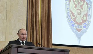 Russian President Vladimir Putin speaks at a meeting with top officials of the Federal Security Service (FSB) at its headquarters in Moscow, Russia, Wednesday, March 6, 2019. Putin urged the agency to tighten the protection of information related to new weapons. (Alexei Druzhinin, Sputnik, Kremlin Pool Photo via AP)