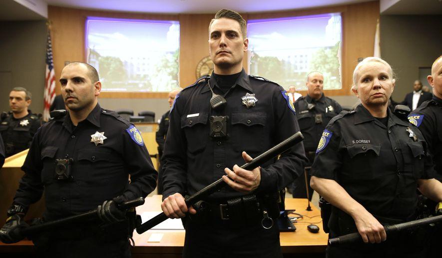 Sacramento police say they saw flash in Stephon Clark's hand