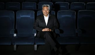 FILE - In this Feb. 6, 2013, file photo, Kevin Tsujihara, poses for photos in a screening room at the Warner Bros. Studios in Burbank, Calif. WarnerMedia is investigating claims that Warner Bros. chairman and CEO Tsujihara promised acting roles in exchange for sex as detailed in The Hollywood Reporter, Wednesday, March 6, 2019. (AP Photo/Jae C. Hong, File)