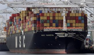 In this Jan. 28, 2019, file photo, a container ship is unloaded at the Port of Oakland in Oakland, Calif. (Associated Press) **FILE**