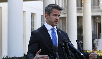 Rep. Adam Kinzinger, R-Ill., speaks to the media, Wednesday, March 6, 2019, at the White House in Washington. (AP Photo/Jacquelyn Martin) ** FILE **