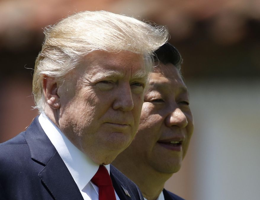 In this April 7, 2017, file photo, U.S. President Donald Trump, left, and Chinese President Xi Jinping walk together at Mar-a-Lago in Palm Beach, Fla. Foreign leaders showered President Donald Trump and his family with more than $140,000 in gifts during their first year in the White House, with China and Saudi Arabia among the most lavish givers. China's president gave Trump and his wife the two most expensive gifts in 2017: a $14,400 calligraphy display and a $16,250 dinnerware set featuring Trump's Mar-a-Lago resort. All gifts were turned over to the National Archives. (AP Photo/AlexBrandon, File)