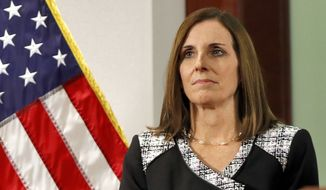 In this Dec. 18, 2018, file photo, then Rep. Martha McSally, R-Ariz., waits to speak during a news conference at the Capitol in Phoenix. (AP Photo/Matt York) ** FILE **