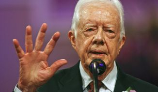 Former President Jimmy Carter speaks in support of his grandson, Georgia Democratic candidate for governor Jason Carter, Sunday, Oct. 12, 2014 at Mt. Zion Baptist Church in Albany, Ga. After an absence of four decades, the former president is returning to the campaign trail this year on behalf of Jason, who's challenging incumbent Republican Gov. Nathan Deal. (AP Photo/Phil Sears)