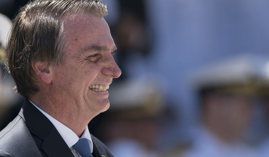 Brazil's President Jair Bolsonaro smiles as he attends a ceremony marking the 211th anniversary of Brazilian Marine Corps in Rio de Janeiro, Brazil, Thursday, March 7, 2019. (AP Photo/Leo Correa)