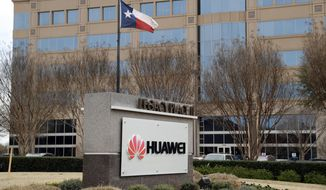 The Texas state flag files outside the Huawei Technologies Ltd. business location in Plano, Texas, Thursday, March 7, 2019. The Chinese tech giant is challenging a U.S. law that would limit its American sales of telecom equipment on security grounds as the company steps up efforts to preserve its access to global markets for next-generation communications. (AP Photo/Tony Gutierrez)