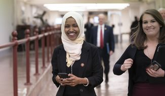"""Rep. Ilhan Omar, D-Minn., walks to the chamber Thursday, March 7, 2019, on Capitol Hill in Washington, as the House was preparing to vote on a resolution to speak out against, as House Speaker Nancy Pelosi said, """"anti-Semitism, anti-Islamophobia, anti-white supremacy and all the forms that it takes,"""" an action sparked by remarks from Omar. (AP Photo/J. Scott Applewhite)"""